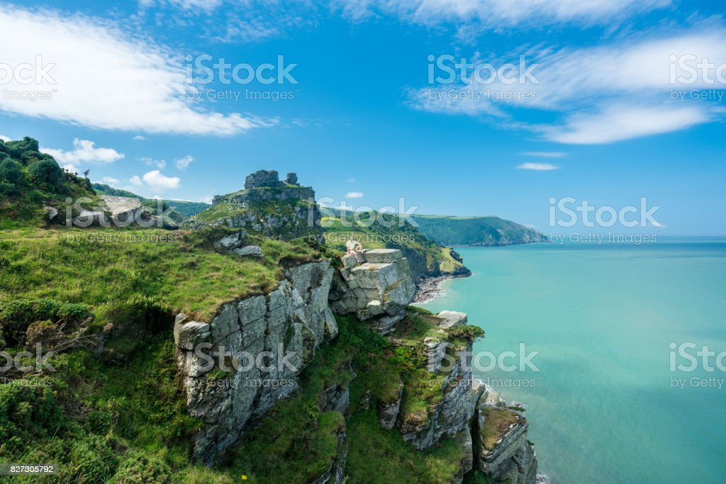 The South West Coast Path near Lynmouth Hiker on the headland in Valley of the Rocks on South West coast path near Lynmouth Adult Stock Photo