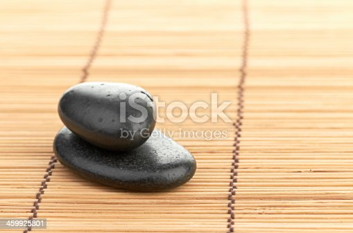 459851883 istock photo The spa a stone on bamboo background 459925801