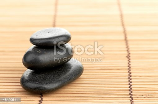 459851883 istock photo The spa a stone on bamboo background 464205111