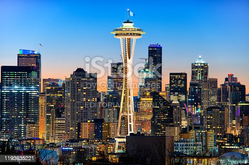 Seattle, Washington - August 26th, 2016: Its the Space Needle with the 12th man fan flag and Seattle skylines at dawn seen from the Kerry park in Downtown Seattle, Washington.