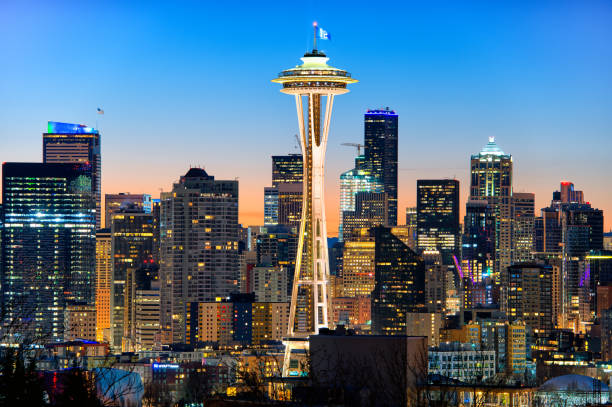 The Space Needle and Seattle Skylines at Dawn stock photo
