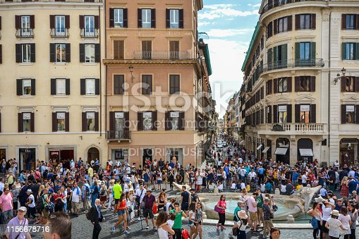 Rome, Italy - June 28, 2018: View from the Spanish steps in Rome, tourists around the famous Fontana della Barcaccia. Spanish Steps are one of Rome's most popular tourist attractions. The monumental stairway of 174 steps was designed by architects Francesco de Sanctis and Alessandro Specchi.