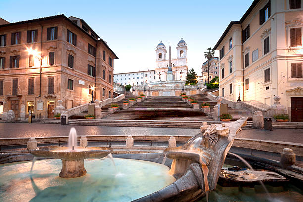 "The Spanish Steps, Rome, Italy The Spanish Steps in Rome. In the foreground is the fountain called Fontana della Barcaccia ""Fountain of the Old Boat"" rome italy stock pictures, royalty-free photos & images"