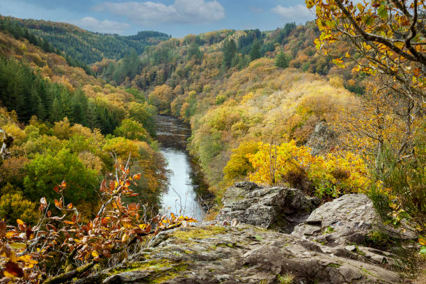 The spectacular cliff Le Herou near the Ourthe river in the Ardennes forest of Wallonia stock photo