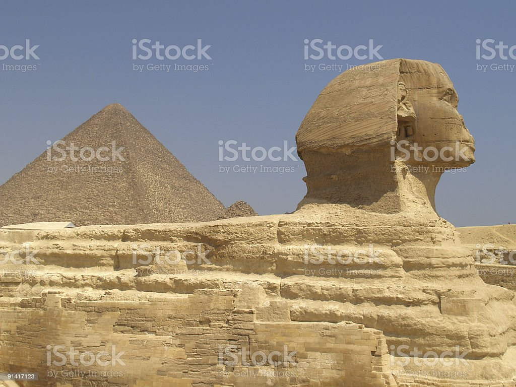 The sphinx and pyramids stock photo
