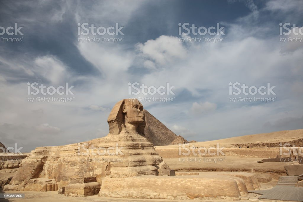 The Sphinx at Giza and ancient Egyptian pyramid stock photo
