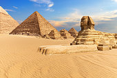 The Sphinx of Giza next to the Pyramids in the desert, Egypt.