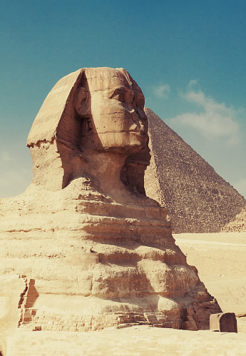 The famous Sphinx with the Great Pyramid of Cheops as background.