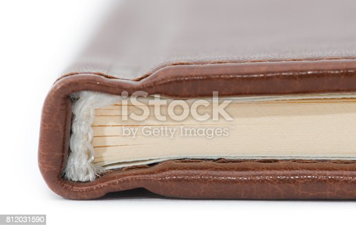 480762174istockphoto the spine of the book close-up on a light background 812031590