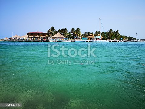 Blue green waters. Looking across to the Spit. A cafe bar strip of Caye Caulker, Belize