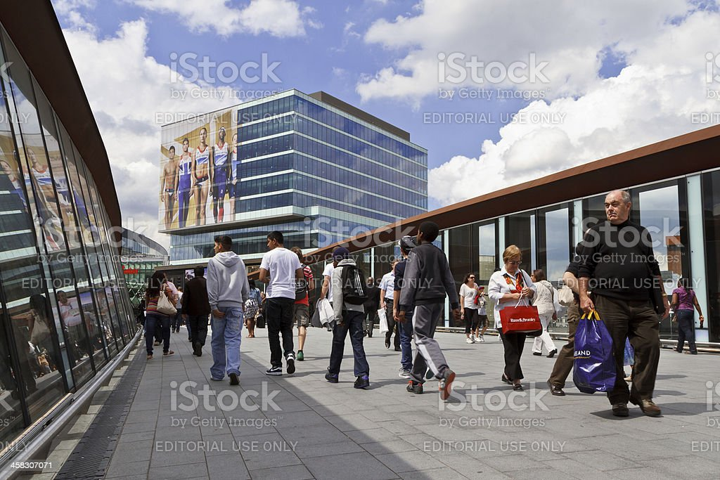The Sport of Shopping London, UK - July 5, 2012: People crossing footbrigde to Olympic decorated Westfield Stratford City Shopping Mall at Olympic Park 2012 Stock Photo