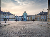 The square of Amalienborg Royal Palace . Copenhagen, Denmark, dawn