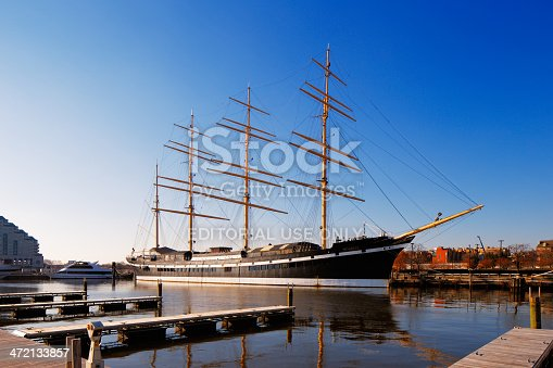 Philadelphia, USA - December 1, 2013: The square-rigged tall sailing ship, Mosholu, stands reflective and graceful in the still waters of Penn's Landing, City of Philadelphia