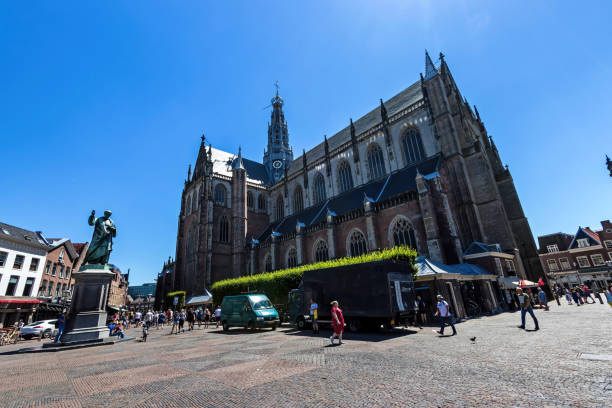 The St. Bavo Church and Grote Markt stock photo