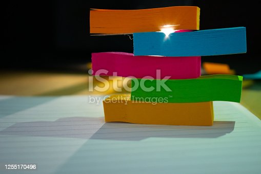 804299508 istock photo the stack of vivdful color paper close up beautiful abstract office bacground 1255170496