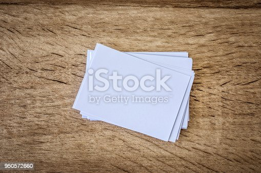 968272356istockphoto the stacking of mockup empty white business card  on wooden background , template for business  branding  design 950572660