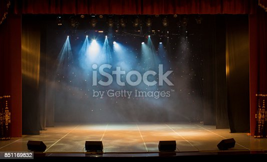 istock The stage of the theater illuminated by spotlights and smoke from the auditorium 851169832