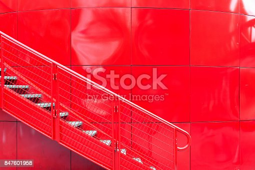 istock The staircase on the red wall 847601958