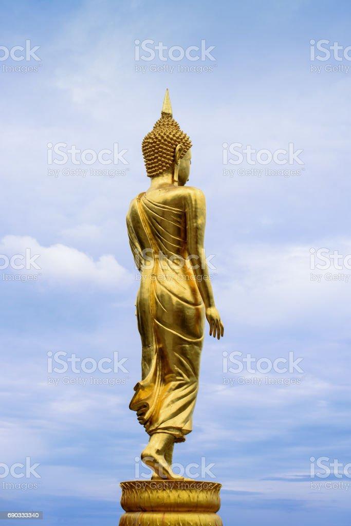 The standing Buddha statute in Thailand stock photo