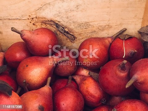 red crimson pear in wooden crate