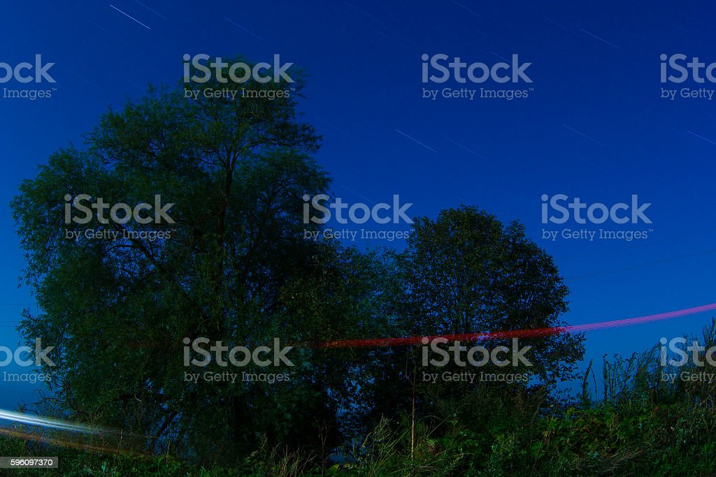 The starry sky and the mist over the land royalty-free stock photo