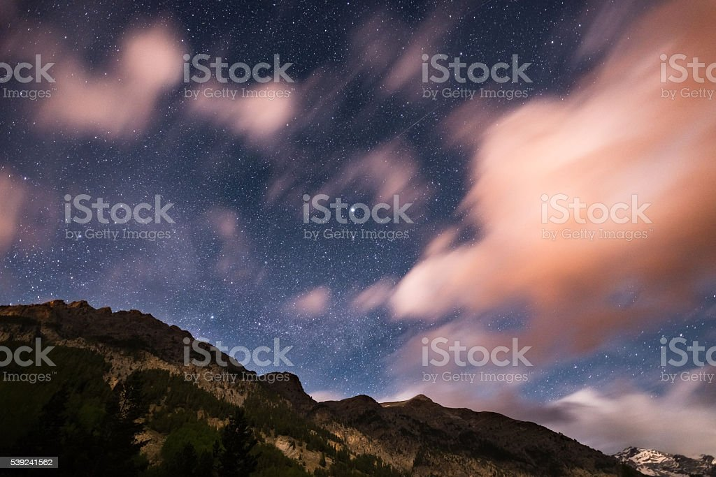 The starry sky over Alps with blurred motion colorful clouds royalty-free stock photo