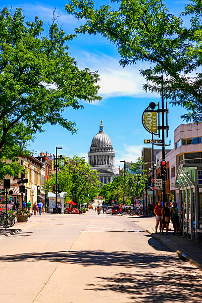 The State Capitol building in Madison Wisconsin Madison, WI, USA - July 29, 2015: View of State street looking towards the State Capitol building in Madison Wisconsin wisconsin state capitol stock pictures, royalty-free photos & images