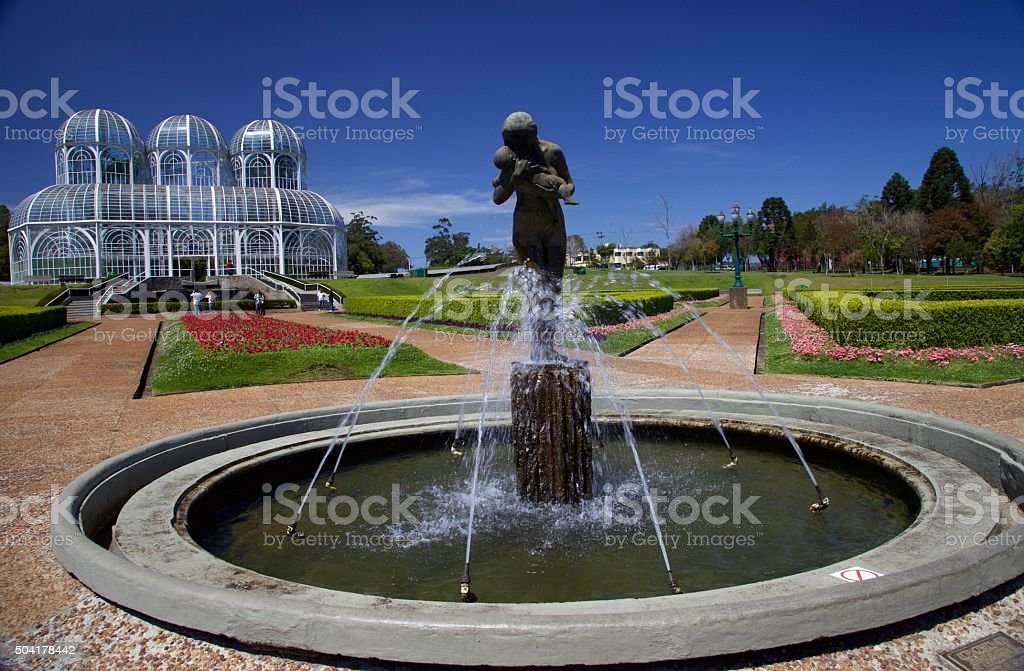 The statue and the greenhouse stock photo