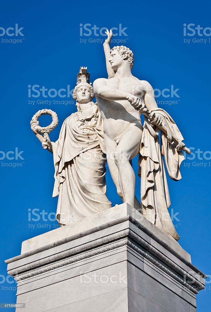 The statue of Athena with a young man royalty-free stock photo