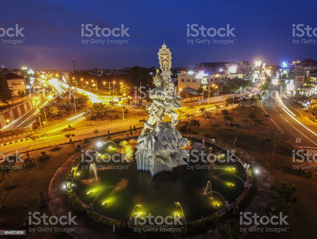 The Statue of Dewa Ruci in the Middle of Highway in Denpasar Bali Indonesia stock photo