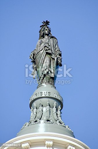 The Statue of Freedom, also known as Armed Freedom or simply Freedom, is a bronze statue designed by Thomas Crawford, that, since 1863, has crowned the dome of the U.S. Capitol building in Washington, D.C.