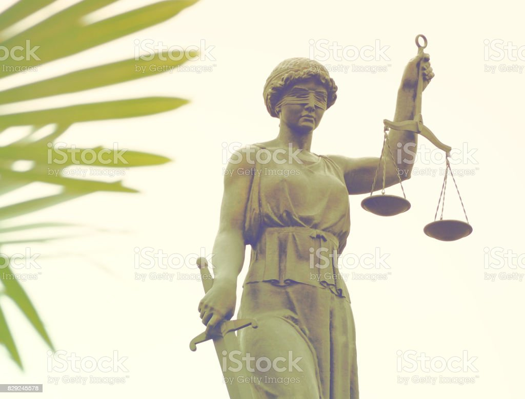 the statue of goddess of justice Themis close-up stock photo