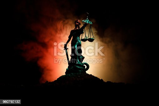 istock The Statue of Justice - lady justice or Iustitia / Justitia the Roman goddess of Justice on a dark fire background 960792132