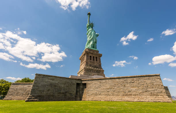The Statue of Liberty on Its Pedestal The Statue of Liberty stands on its pedestal overlooking New York Harbor. liberty island stock pictures, royalty-free photos & images