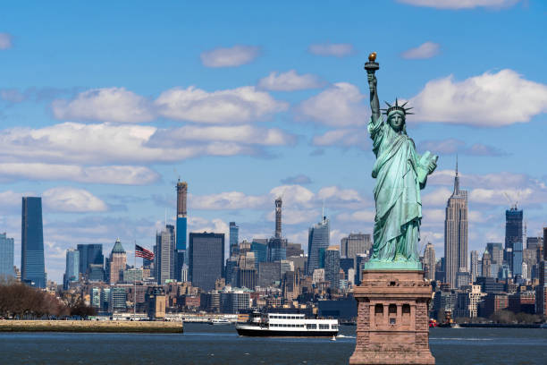 The Statue of Liberty over the Scene of New York cityscape