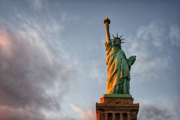 The Statue of Liberty Lady Liberty amongst the clouds immigrant stock pictures, royalty-free photos & images