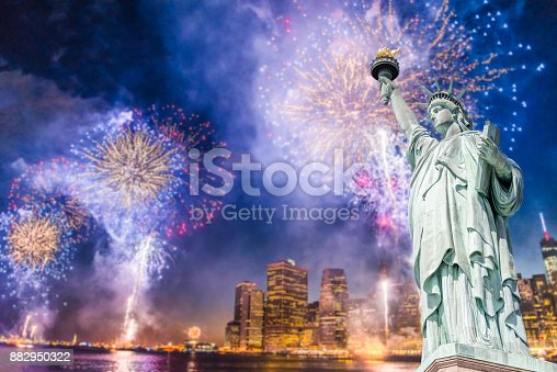 istock The Statue of Liberty with blurred background of cityscape with beautiful fireworks at night, Manhattan, New York City 882950322