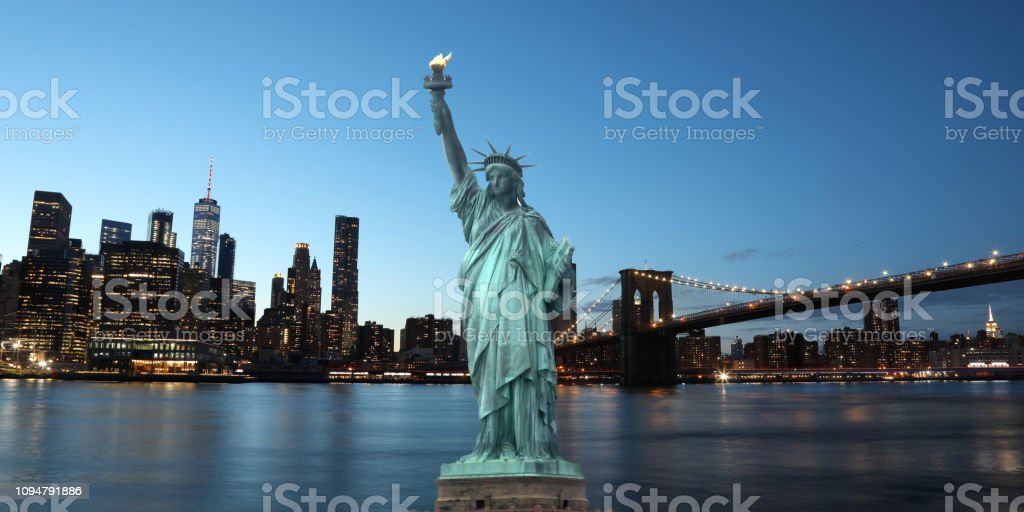 The Statue of Liberty with Brooklyn Bridge Manhattan downtown skyline skyscrapers New York City USA The Statue of Liberty with Brooklyn Bridge Manhattan downtown skyline skyscrapers New York City USA Architecture Stock Photo