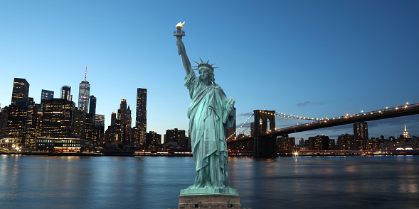 The Statue Of Liberty With Brooklyn Bridge Manhattan Downtown Skyline Skyscrapers New York City Usa Stock Photo - Download Image Now