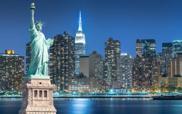 The Statue of Liberty with cityscape in Manhattan at night, New York City The Statue of Liberty with cityscape in Manhattan at night, New York City, USA liberty island stock pictures, royalty-free photos & images