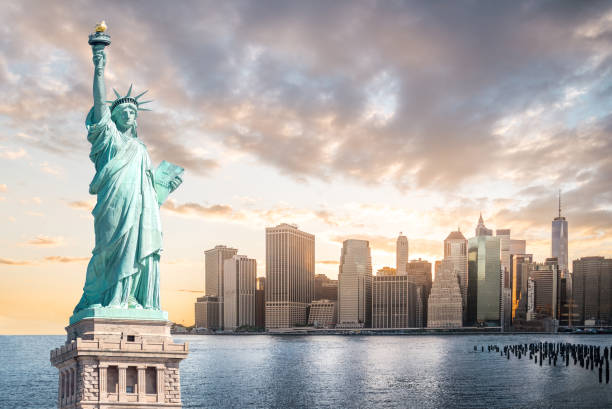 The Statue of Liberty with Lower Manhattan background in the evening at sunset, Landmarks of New York City The Statue of Liberty with Lower Manhattan background in the evening at sunset, Landmarks of New York City, USA liberty island stock pictures, royalty-free photos & images
