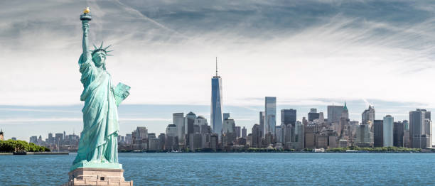 The Statue of Liberty with One World Trade Center background, Landmarks of New York City stock photo