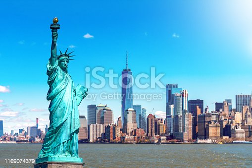 istock The Statue of Liberty with the One world Trade building center over hudson river and New York cityscape background, Landmarks of lower manhattan New York city. Architecture and building concept 1169074379