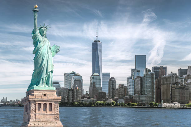 The statue of Liberty with World Trade Center background, Landmarks of New York City stock photo