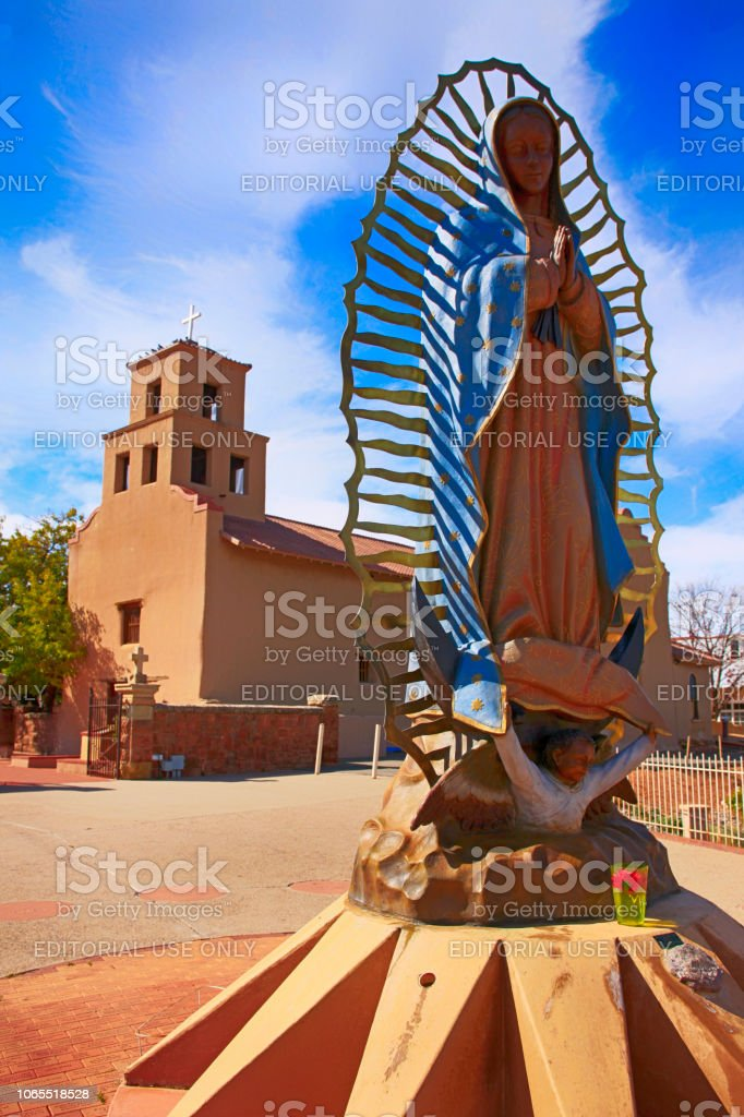 The statue of Nuestra Senora de Guadalupe outside the historic Sanctuario de Guadalupe Catholic church in Santa Fe, New Mexico USA stock photo