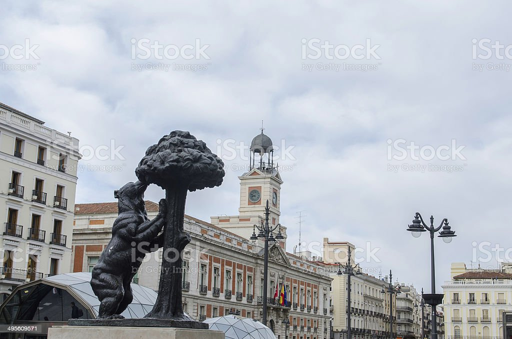 The statue of the bear and the strawberry tree stock photo