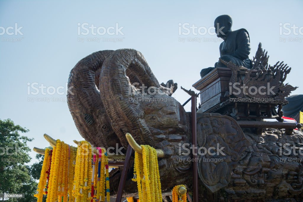 The statue of the monk looks calm. stock photo