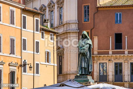 The statue of Giordano Bruno in Campo de Fiori square, one of the most loved and visited places by tourists, located in the heart of Rome between Piazza Farnese and Piazza Navona. The bronze statue of the religious and philosopher Giordano Bruno, created by the sculptor Ettore Ferrari in 1889, was erected in the place where he was condemned to the stake by the Holy Inquisition in 1600. Image in high definition format.