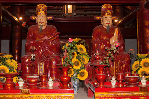 The statues of Chinese philosophers Mencius (left) and Zengzi (right) in the Temple of Literature stock photo