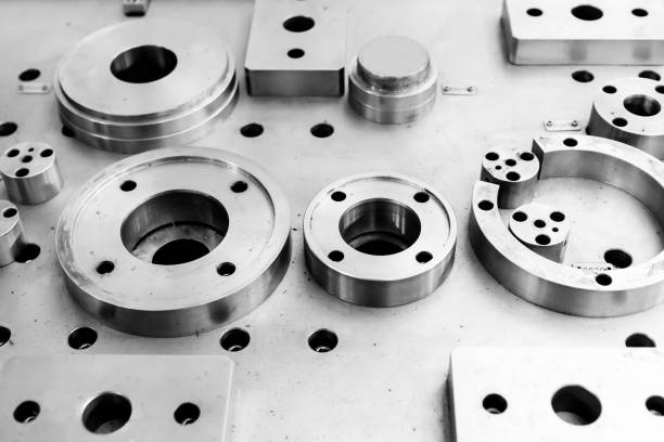 The steel cylindrical parts are on the machine platform stock photo